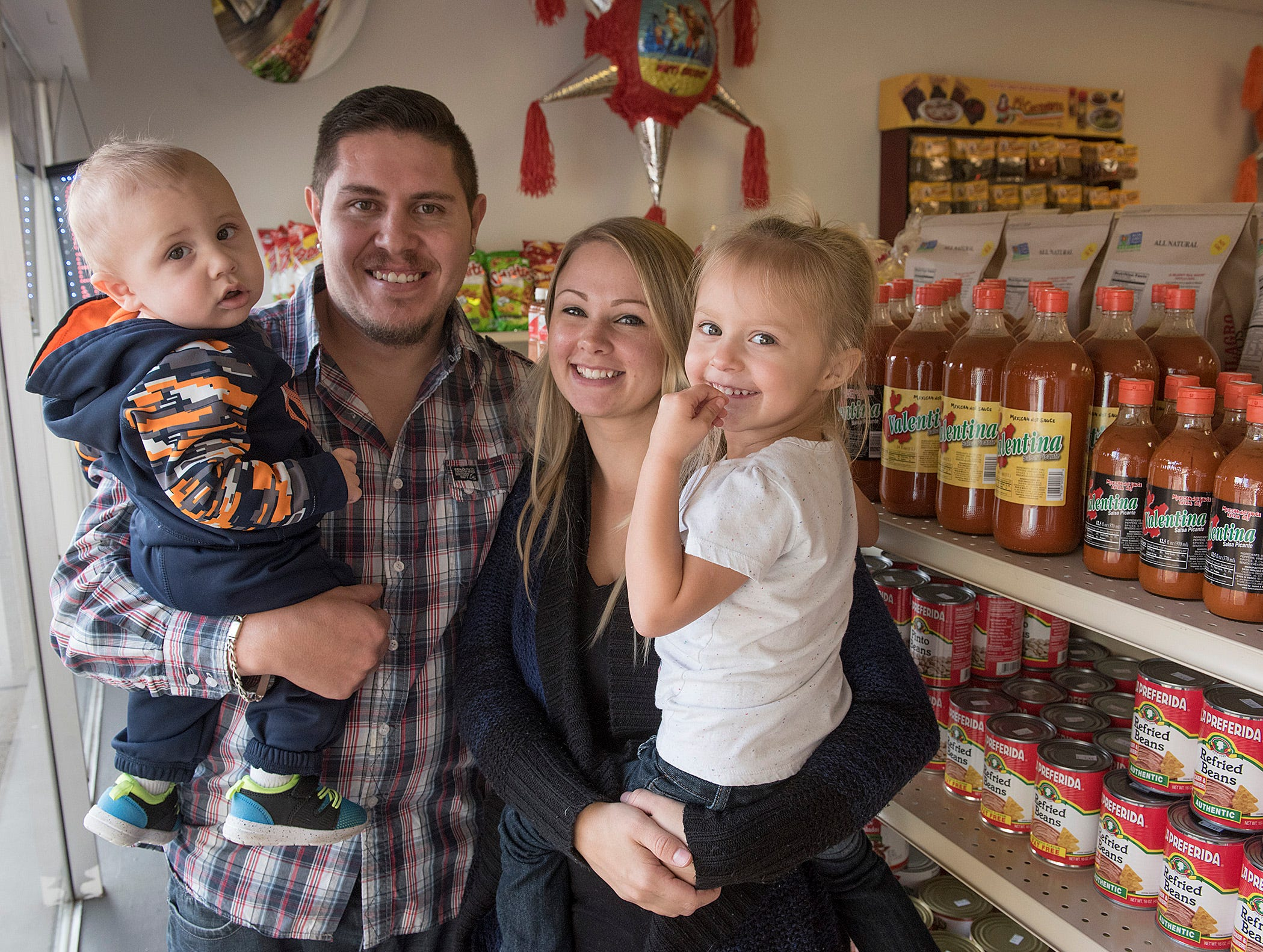 Francisco and Erin Penaloza opened their store in Livonia. Geovani, 10 months old, and Penelope, 3 years old, spend time there, too.