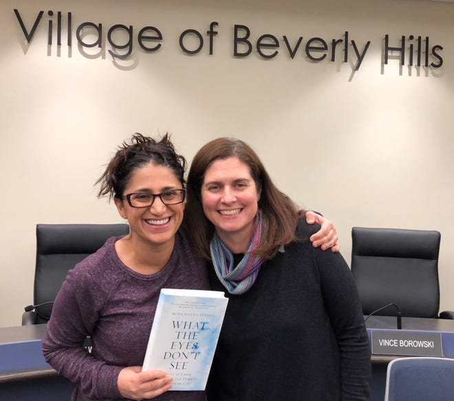 "Award-winning activist, scientist and physician Dr. Mona Hanna-Attisha and her friend and colleague Elin Betanzo share a moment of fun prior to the meeting of the Huntley Book Club's discussion of ""What the Eyes Don't See."""