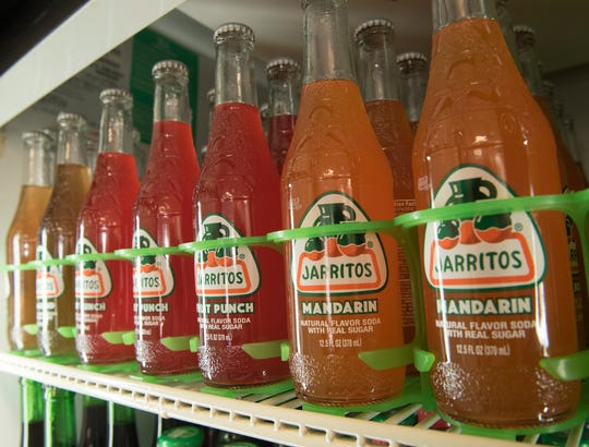 Jarritos, a popular soft drink known for its real sugar, is for sale in the cooler.