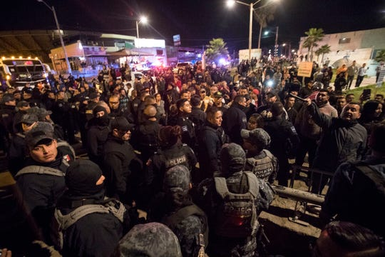 "Mexican residents of Playas De Tijuana confronted Honduran migrants who had set up a makeshift camp at ""Friendship Park"" in Playas De Tijuana. The Mexican residents demanded that the the migrants leave the area and threaten the migrants if they did not leave. Federal and Municipal Mexican police kept both groups separated and some incidents of violence broke out throughout the night."