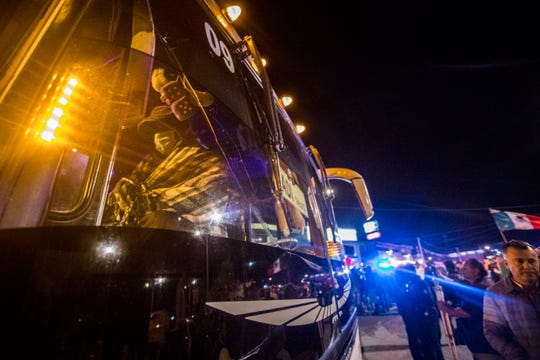 """A Honduran immigrant boards a bus taking them to a shelter as Mexican residents of Playas De Tijuana confronted the migrants who had set up a makeshift camp at """"Friendship Park"""" in Playas De Tijuana. The Mexican residents demanded that the the migrants leave the area and threaten the migrants if they did not leave. Federal and Municipal Mexican police kept both groups separated and some incidents of violence broke out throughout the night."""