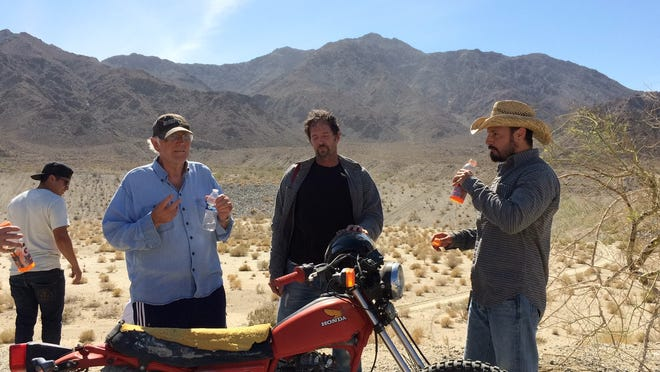 """In this 2016 photo, """"Do it or Die"""" director Jorn Winther, left, talks to lead actor Andrew McGuinness, right, and his stunt double during a film shoot in La Quinta. Winther was identified as the victim of a fatal collision in Palm Desert on Nov. 9."""