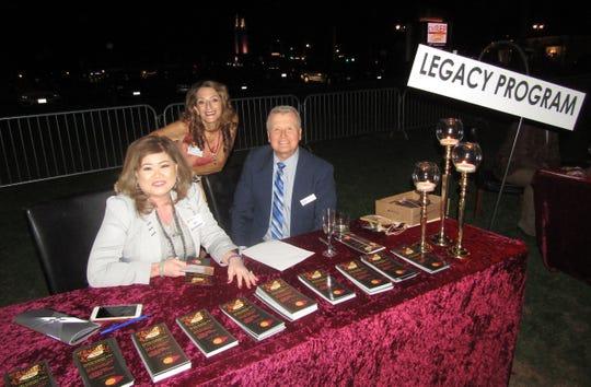 Manning the Legacy booth  Luz Bochnewich, Atma Wiseman, and Peter Bochnewich.