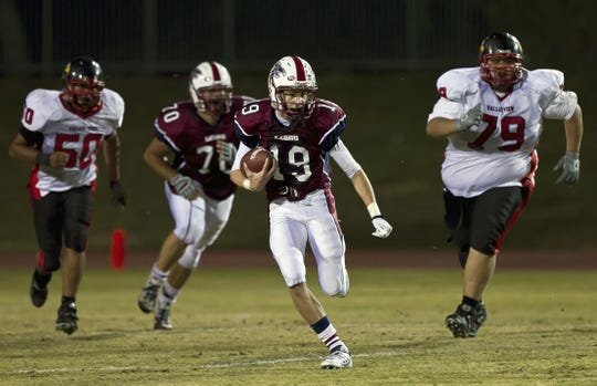 La Quinta's Taylor Pope runs for a touchdown in the CIF playoffs in 2010.