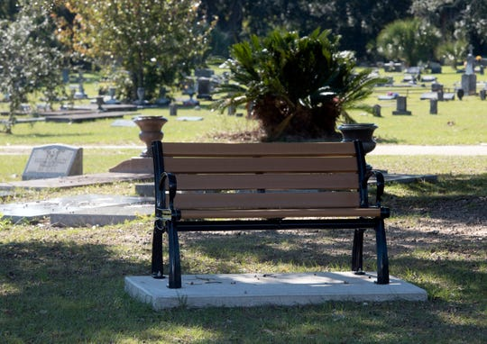Information boards, benches, and other improvements greet visitors to St. John's Cemetery on Thursday, Nov. 15, 2018. A grant from Impact 100 funded the improvements.