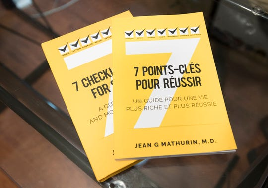 "Haitian born U.S. Navy flight surgeon Jean Mathurin has written a book ""7 Checklist Items for Success"" that is currently available in English and French.  The proceeds from the book are going to help people in his native Haiti."