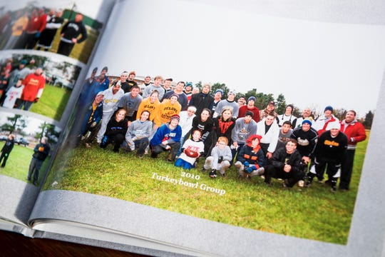 A photo from the 2010 Zinn family and friends Turkey Bowl is displayed in the scrapbook John Zinn put together.