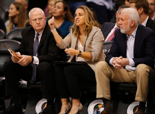 San Antonio Spurs assistant coach Becky Hammon, center, coaches from the bench, during a NBA game against the Phoenix Suns at Talking Stick Arena in Phoenix on November 14.