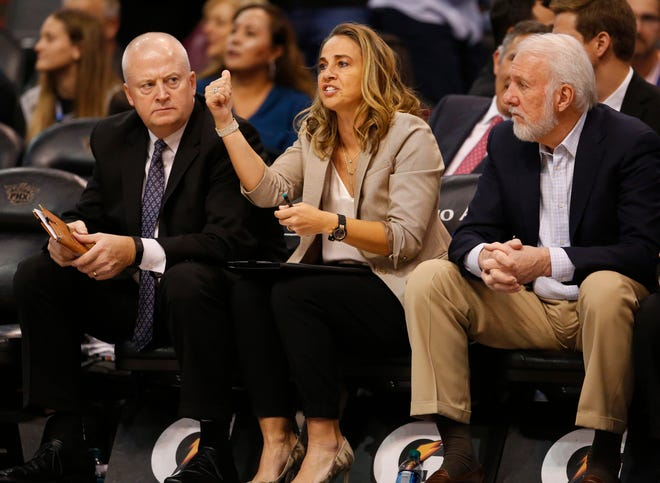Spurs assistant coach Becky Hammon directs her players from the bench during a game Wednesday at Talking Stick Resort Arena.
