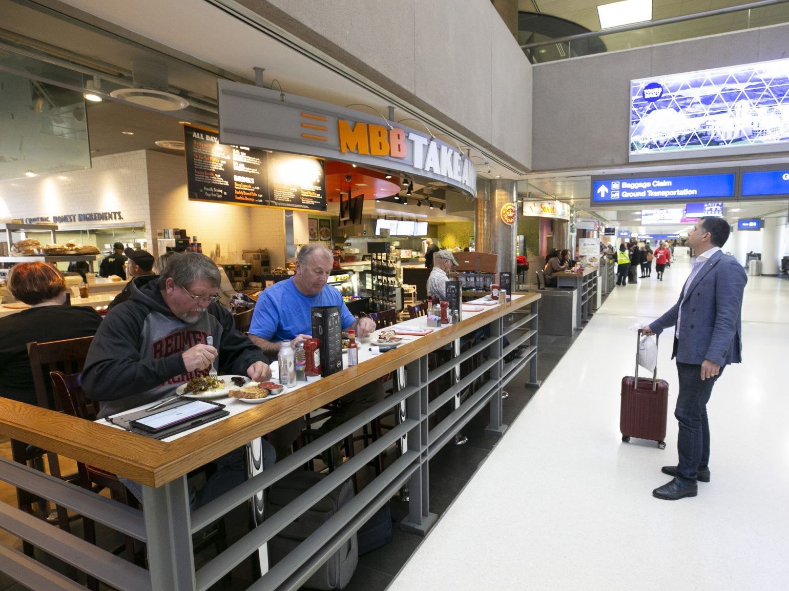 Travelers eat at Matt's Big Breakfast in Terminal Four of Phoenix Sky Harbor International Airport on Tuesday, November 13, 2018.