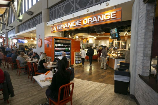 Travels eat at La Grande Orange in Terminal Four of Phoenix Sky Harbor International Airport on Tuesday, November 13, 2018.