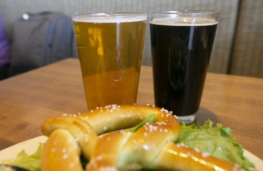 Sunbru (left) and Pumpkin Porter at Four Peaks Brewery in Terminal Four of Phoenix Sky Harbor International Airport on Tuesday, November 13, 2018.