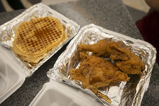The Lo-Lo's (3 pieces of Chicken and waffles) from Lo-Lo's Chicken & Waffles in lobby of the third floor of Terminal Four of Phoenix Sky Harbor International Airport on Tuesday, November 13, 2018.