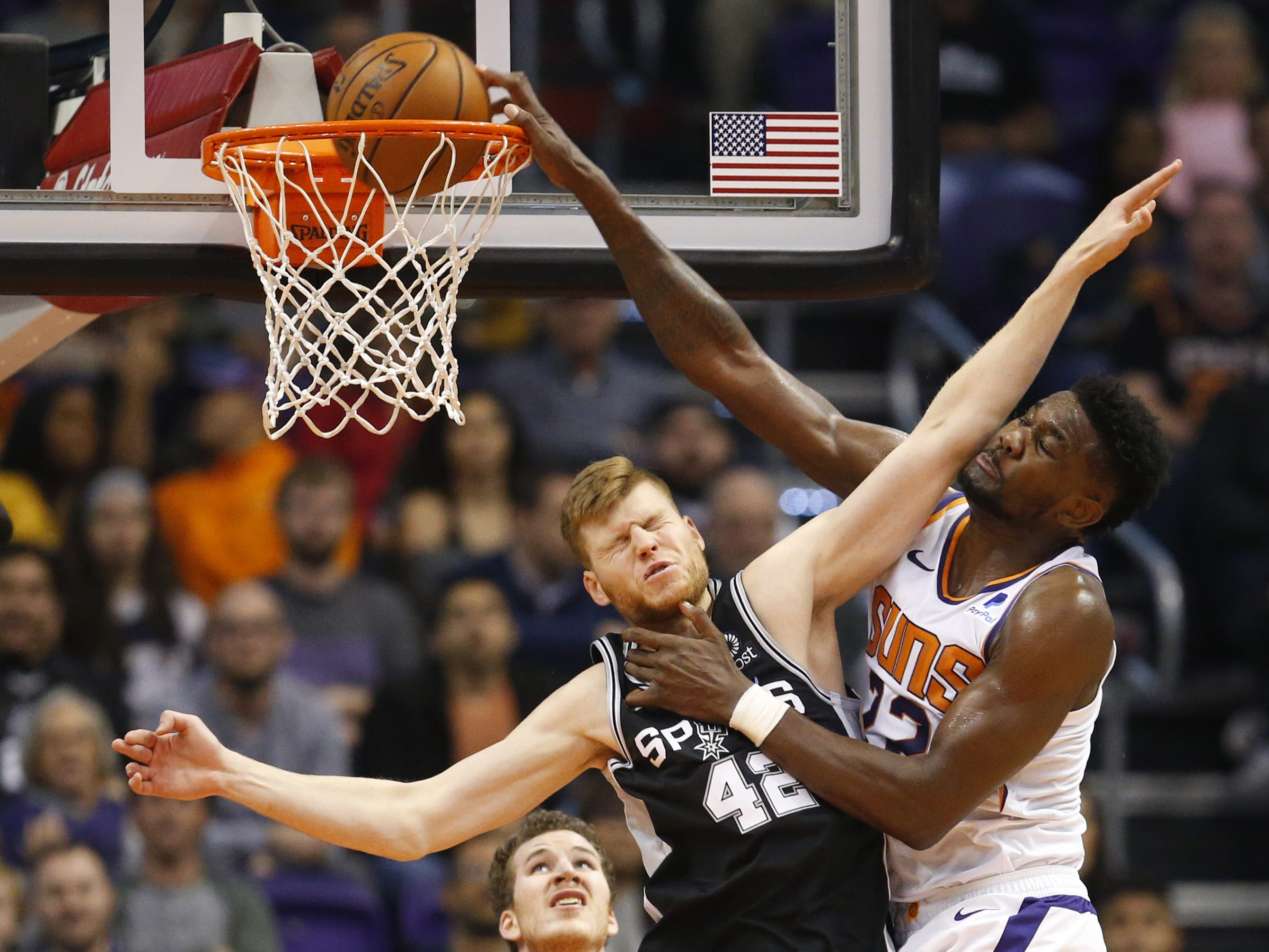Phoenix Suns center Deandre Ayton (22) is fouled by San Antonio Spurs forward Davis Bertans (42) while making a basket during a NBA game at Talking Stick Arena in Phoenix on November 14.
