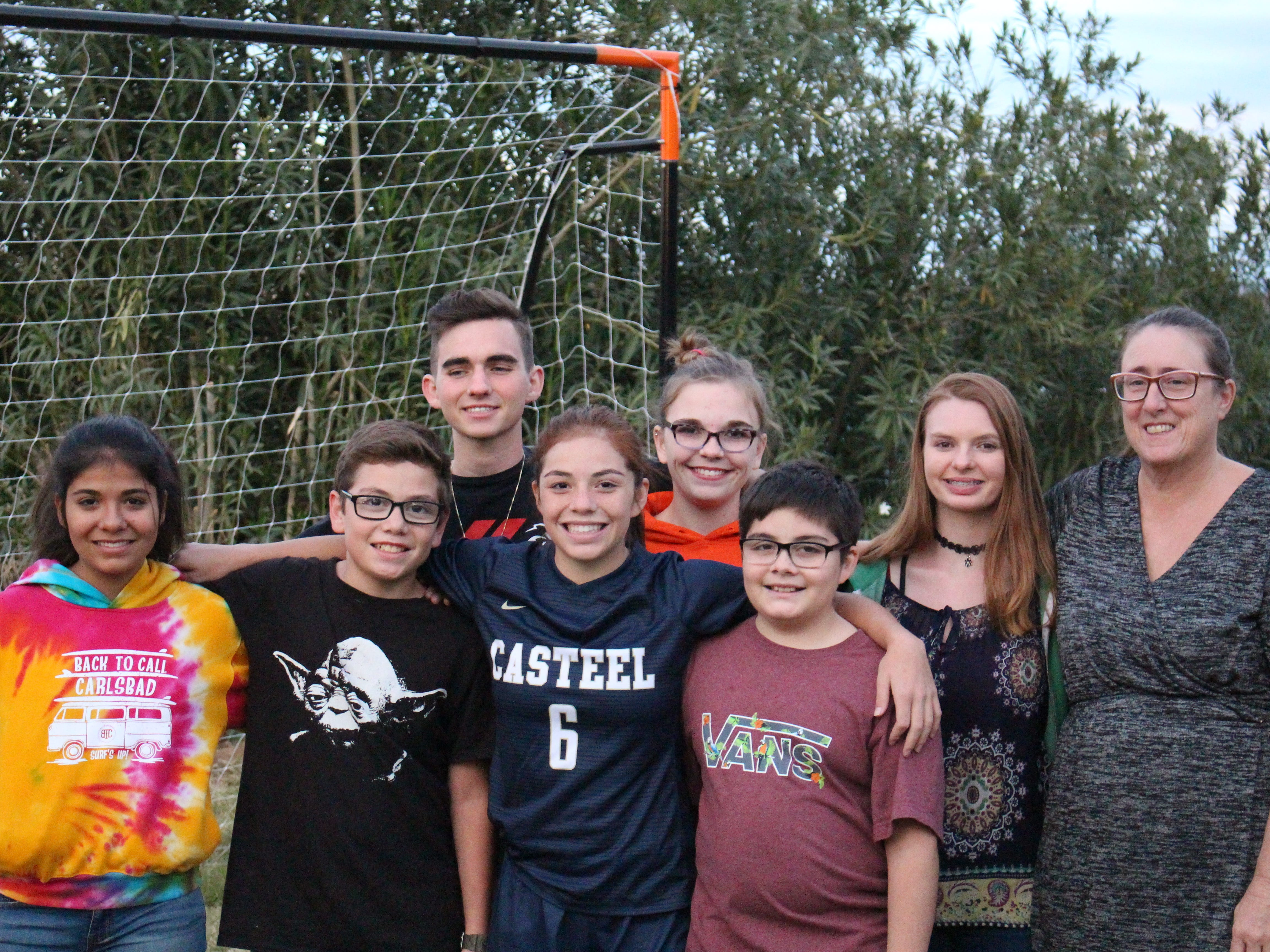 Casteel's Scarlett Frohardt's family (from back row left to right) Connor, Charlotte, Sierra, Laura, (front row left to right) Colette, Cooper, Scarlett and Cannon gather around outside on Wednesday in Queen Creek on Nov. 14, 2018.