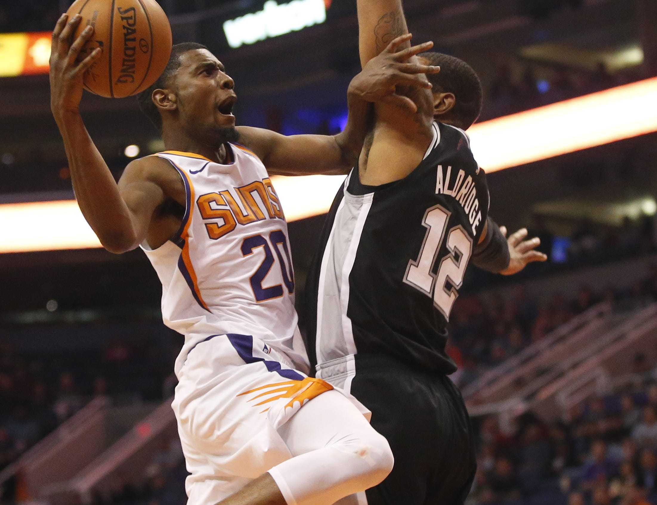 The Suns' Josh Jackson (20) shoots during Wednesday?s game vs. the Spurs. Visit suns.azcentral.com for a recap.   Cheryl Evans/The Republic Phoenix Suns forward Josh Jackson (20) takes a shot wile being guarded by San Antonio Spurs forward LaMarcus Aldridge (12) during a NBA game at Talking Stick Arena in Phoenix on November 14.