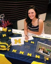 Audrey LeClair, a softball player at Phoenix Country Day, has signed with Michigan.