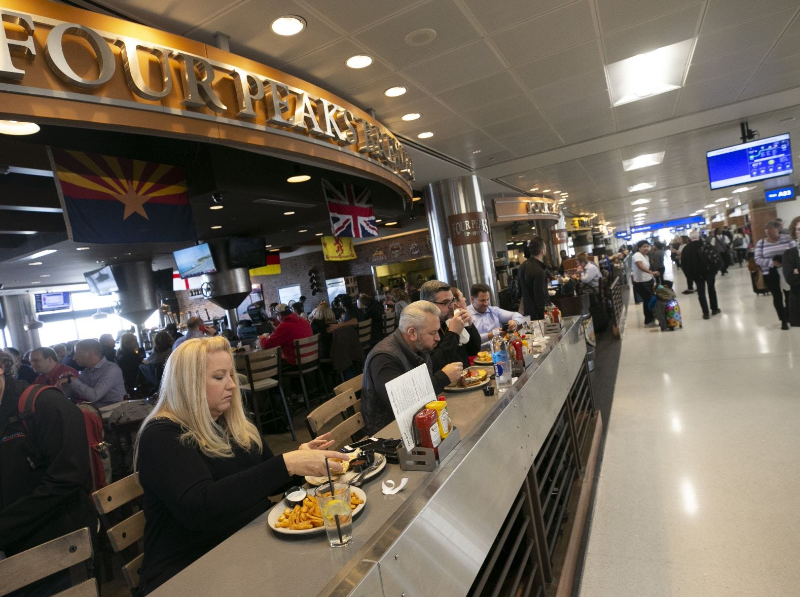 Michelle Ward of Surprise eats at Four Peaks Brewery in Terminal Four of Phoenix Sky Harbor International Airport on Tuesday, November 13, 2018.