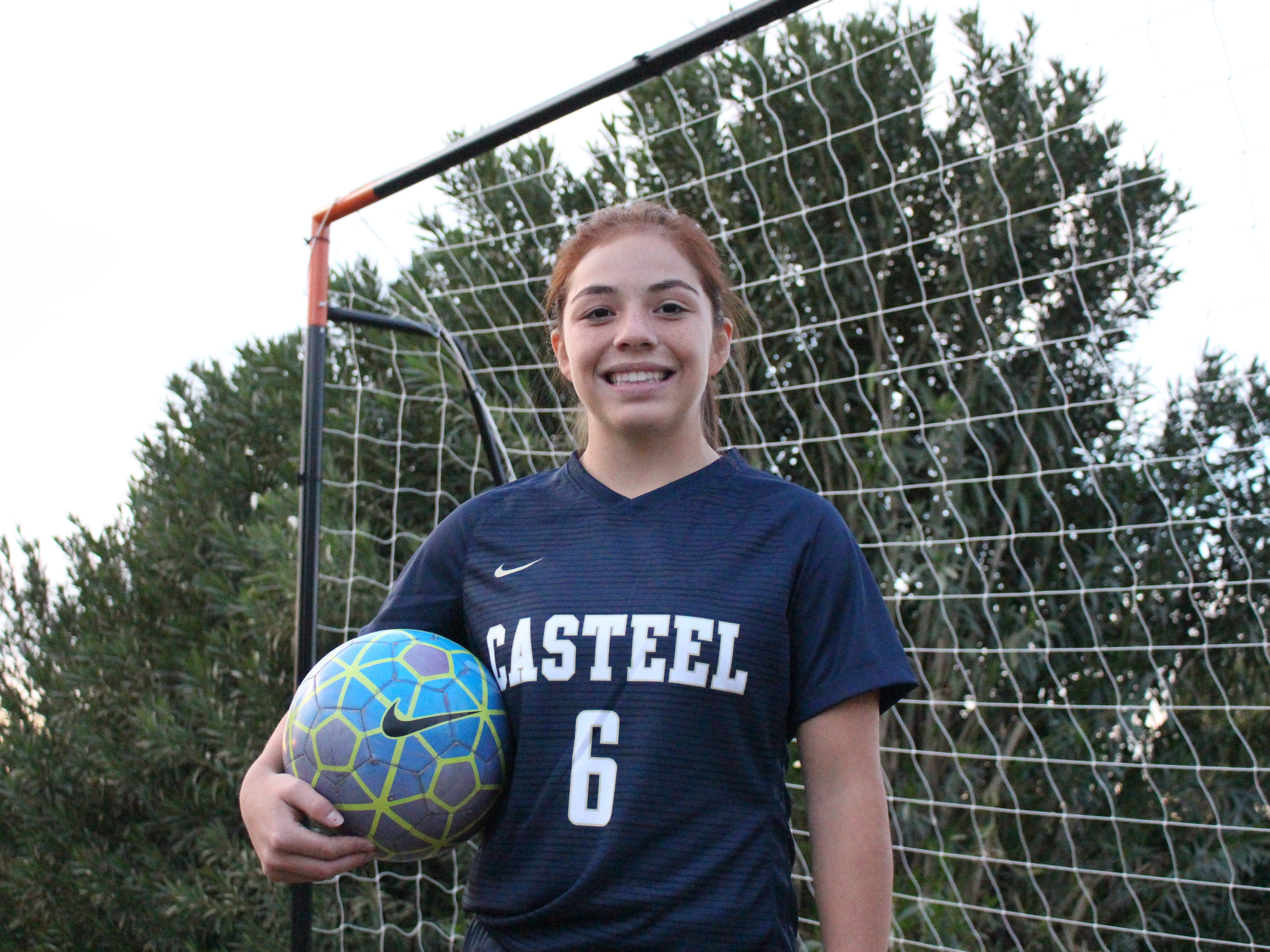 Casteel's Scarlett Frohardt poses near her goal on Wednesday in Queen Creek on Nov. 14, 2018.