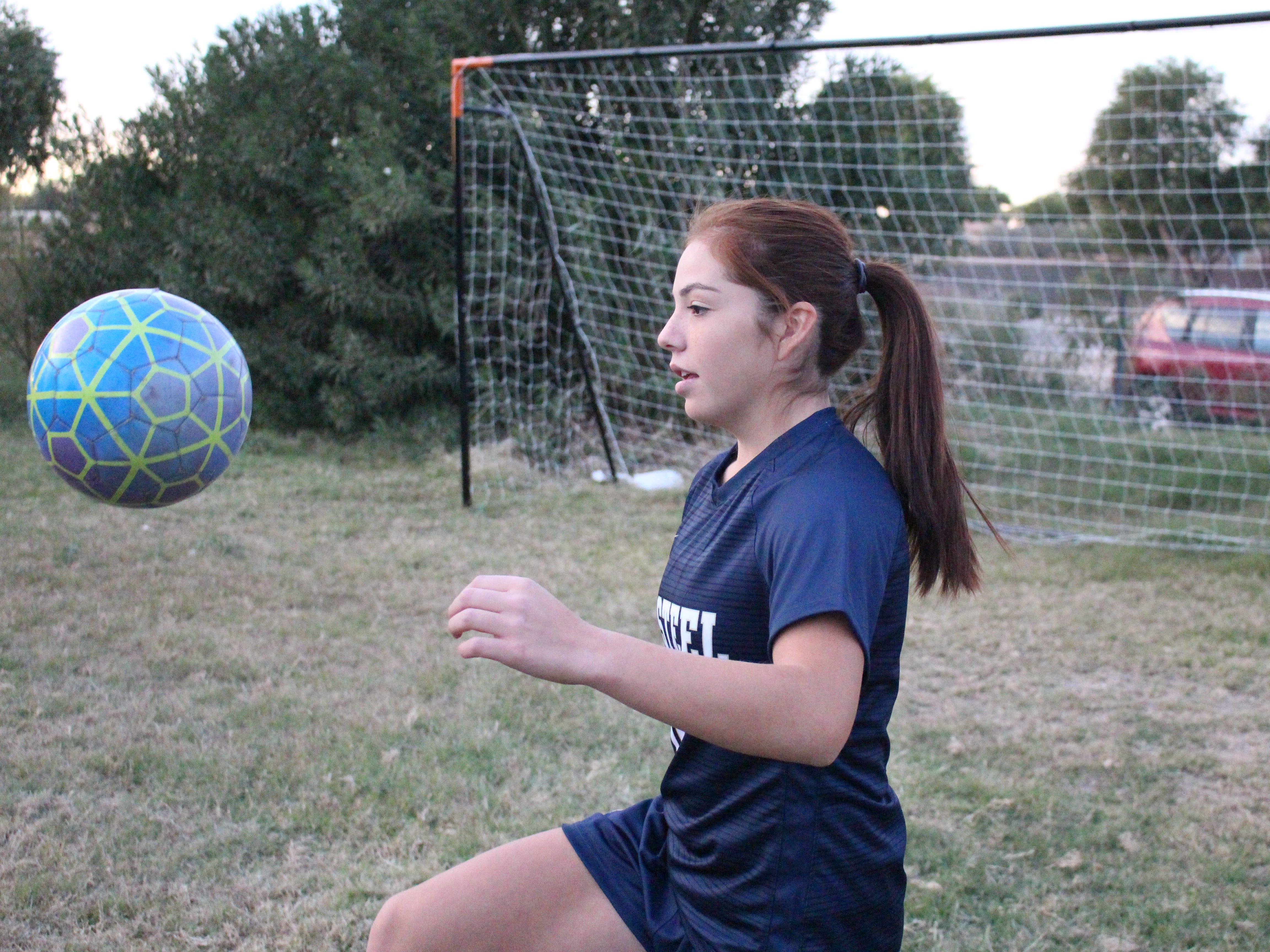 Casteel's Scarlett Frohardt juggles the ball on Wednesday in Queen Creek on Nov. 14, 2018.