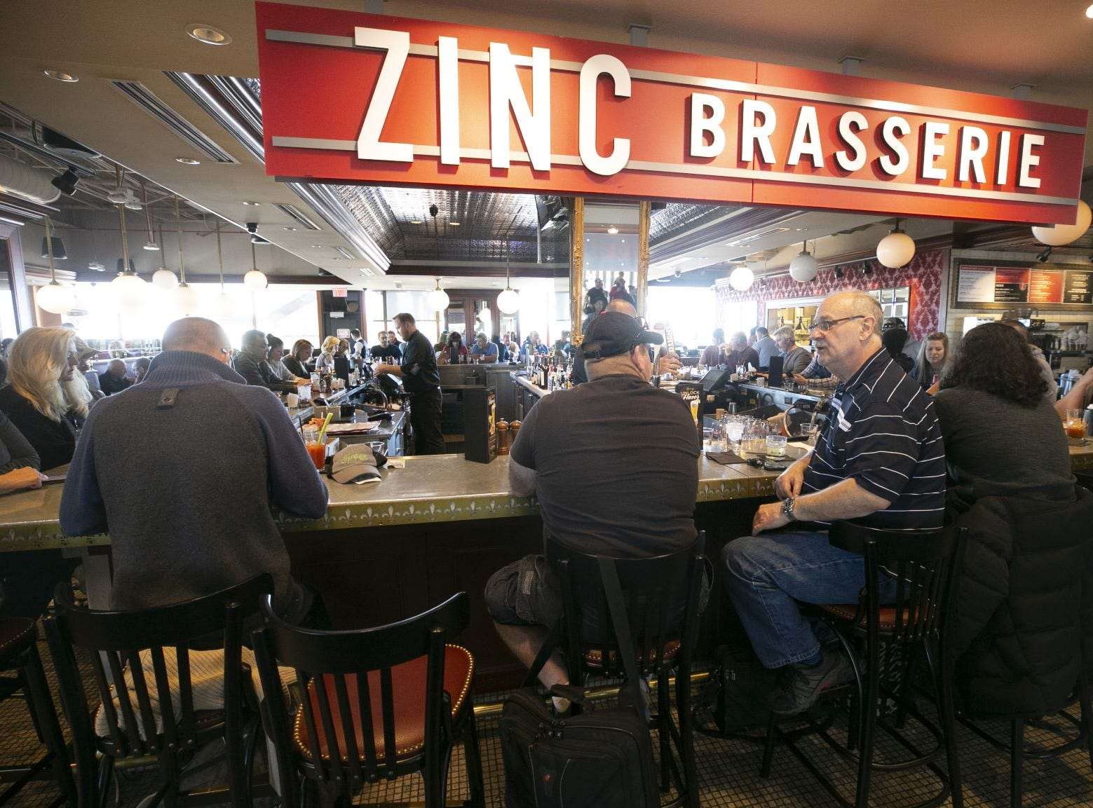 Travelers at Zinc Brasserie In Terminal Four of Phoenix Sky Harbor International Airport on Tuesday, November 13, 2018.