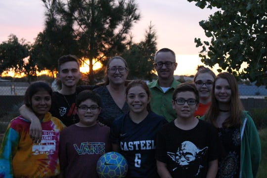 Casteel's Scarlett Frohardt's family (back row left to right) Connor, Laura, John, Charlotte, Sierra, (front row left to right) Colette, Cooper, Scarlett and Cannon gather together for a photograph in Queen Creek.
