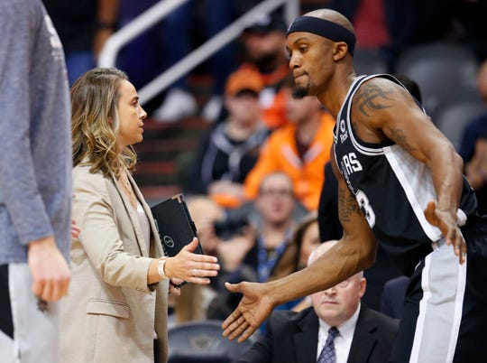 San Antonio Spurs assistant coach Becky Hammon, high fives forward Dante Cunningham (33) before a NBA game against the Phoenix Suns at Talking Stick Arena in Phoenix on November 14.
