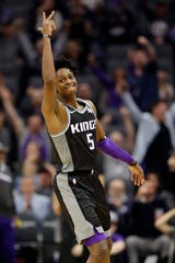 Kings guard De'Aaron Fox celebrates after hitting a three-pointer during the second half of a game against the Spurs on Nov. 12 at Golden 1 Center.