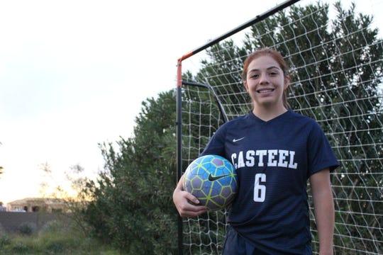 Scarlett Frohardt of the Casteel girls soccer team poses near her goal in Queen Creek.
