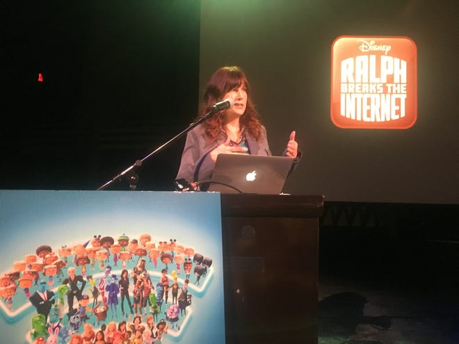 """Michelle Robinson, character look development supervisor for the Disney film """"Ralph Breaks the Internet,"""" talks to students at Grand Canyon University in Phoenix on Nov. 13, 2018."""