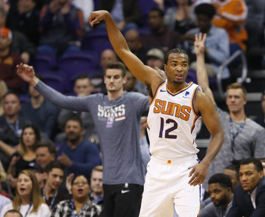 Phoenix Suns forward TJ Warren (12) celebrates a 3 point shot during a NBA game against the San Antonio Spurs at Talking Stick Arena in Phoenix on November 14.