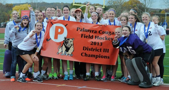 The Palmyra field hockey team poses for their fans after their 2-1 win over Oley Valley on Saturday, November 2, 2013.