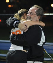 Palmyra field hockey assistant coach Kent Harshman gives Anna Scipioni a hug after a 2-1 overtime victory against Donegal in the district semifinals in 2011. Today, Harshman Is the head coach and Scipioni one of his assistants as Palmyra prepares for Saturday's state title game against Donegal.
