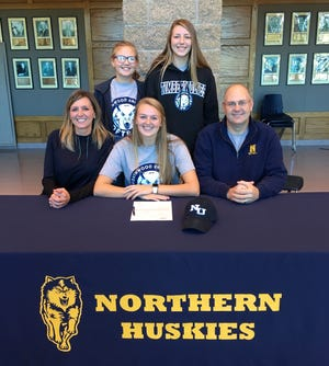 Port Huron Northern senior Riley Shagena poses for a photo with her family, after announcing her decision to attend Northwood Univeristy.