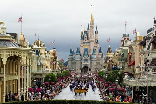 The Port Huron Northern Marching Huskies participate in a daily parade at Disney World.