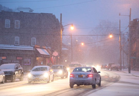 Traffic navigates its way along Main Street/Route 9D in the Village of Wappingers Falls as snow begins to accumulate on November 15, 2018.