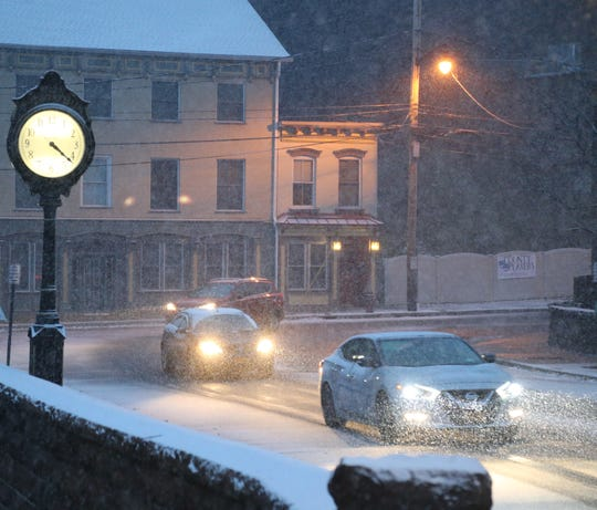 Snow falls as traffic moves along Route 9D in the Village of Wappingers Falls on November 15, 2018.
