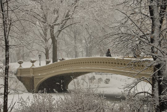 A blanket of snow can turn Central Park into a winter wonderland, such as this scene at Bow Bridge.