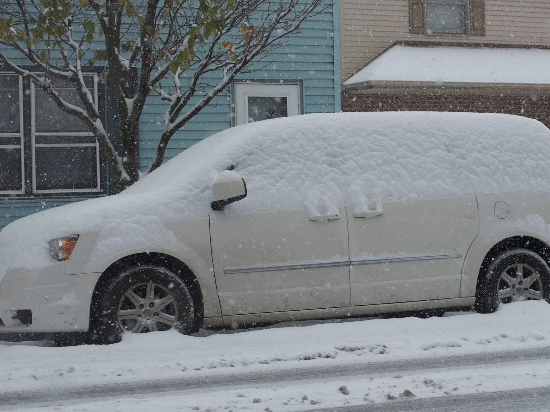 A snow-covered minivan is seen in in Greencastle. Snow started in Franklin County on Thursday morning, November 15, 2018.