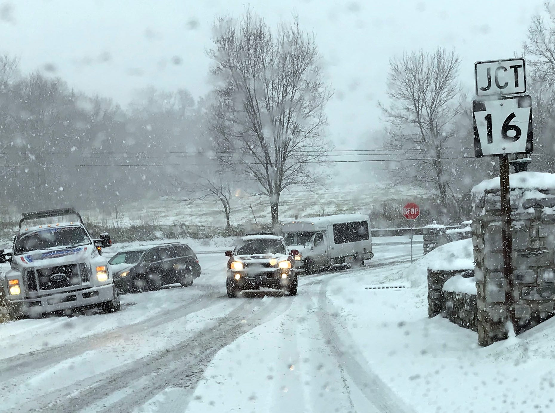 Vehicles have trouble getting up an icy hill in Wayne Castle off Pa. 16. Snow started in Franklin County on Thursday morning, November 15, 2018.