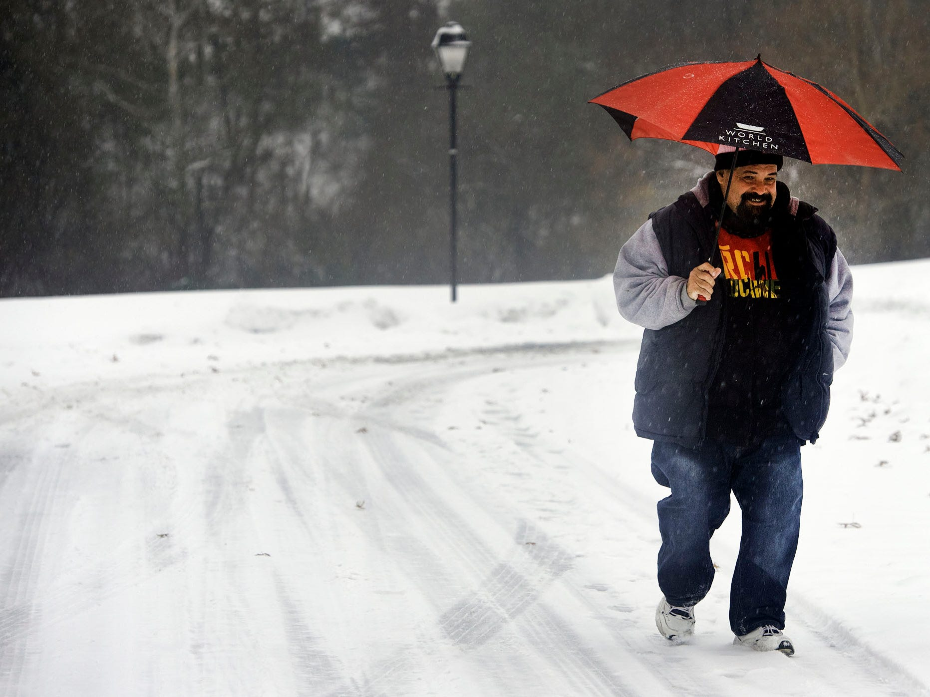 Cesar Ortiz walks along West Catherine Street, Chambersburg, during the storm.  A winter storm hit Franklin County on Thursday morning, November 15, 2018.