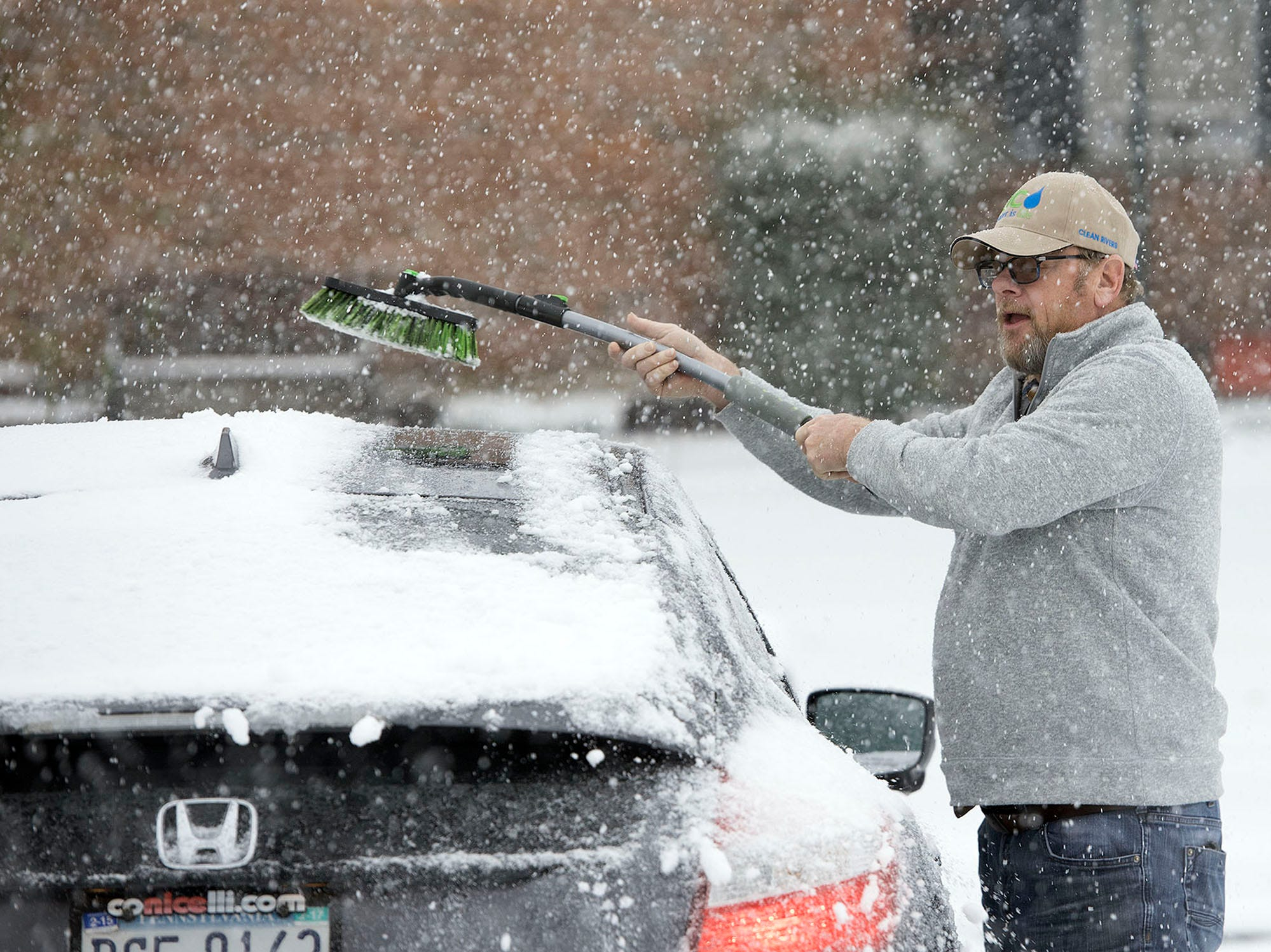 Garry Brennan clears off his car after lunch at a local restaurant in Chambersburg. A winter storm hit Franklin County on Thursday morning, November 15, 2018.