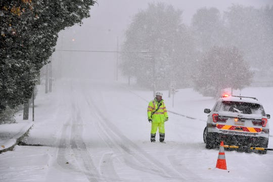 Fire police block the south bound lane of Edgewood Road in Springettsbury Township due to stuck vehicles, Thursday, November 14, 2018. 