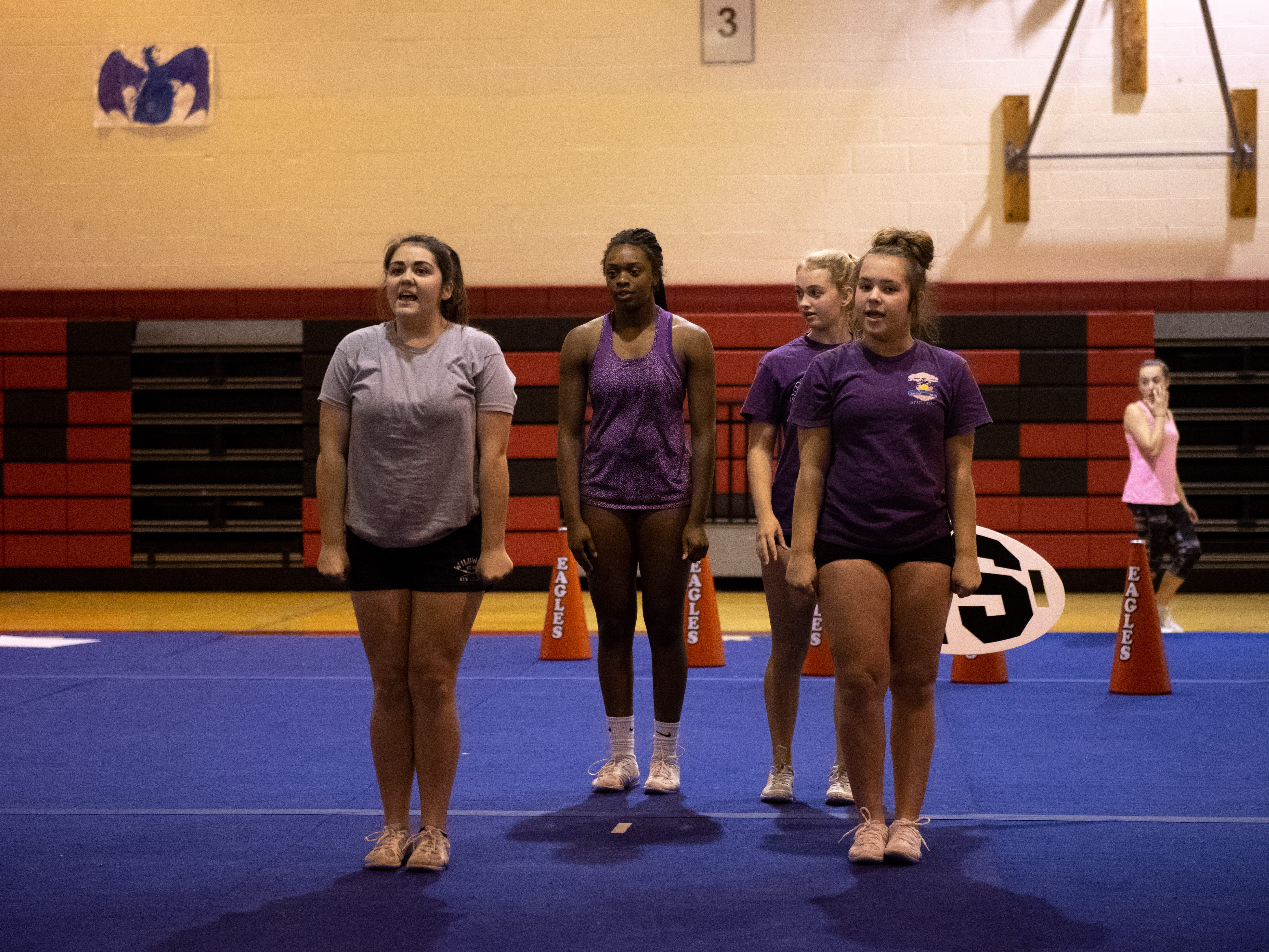 (Left to right) Cayla Lippert, Samira Howard, Londyn Sayers and Brooke Johnson prepare to start the routine during Dover's competitive spirit practice, November 14, 2018.