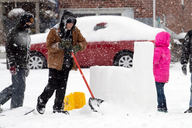 Nick Fagin, 10, center, shovels snow for a snow fort while his friends, Peyton Keener, 11, left, and Isabella Hlombrook, 9, watch, Thursday, Nov. 15, 2018. Central Pa. saw its first snowfall of the season, with an estimated 4 to 8 inches accumulating.