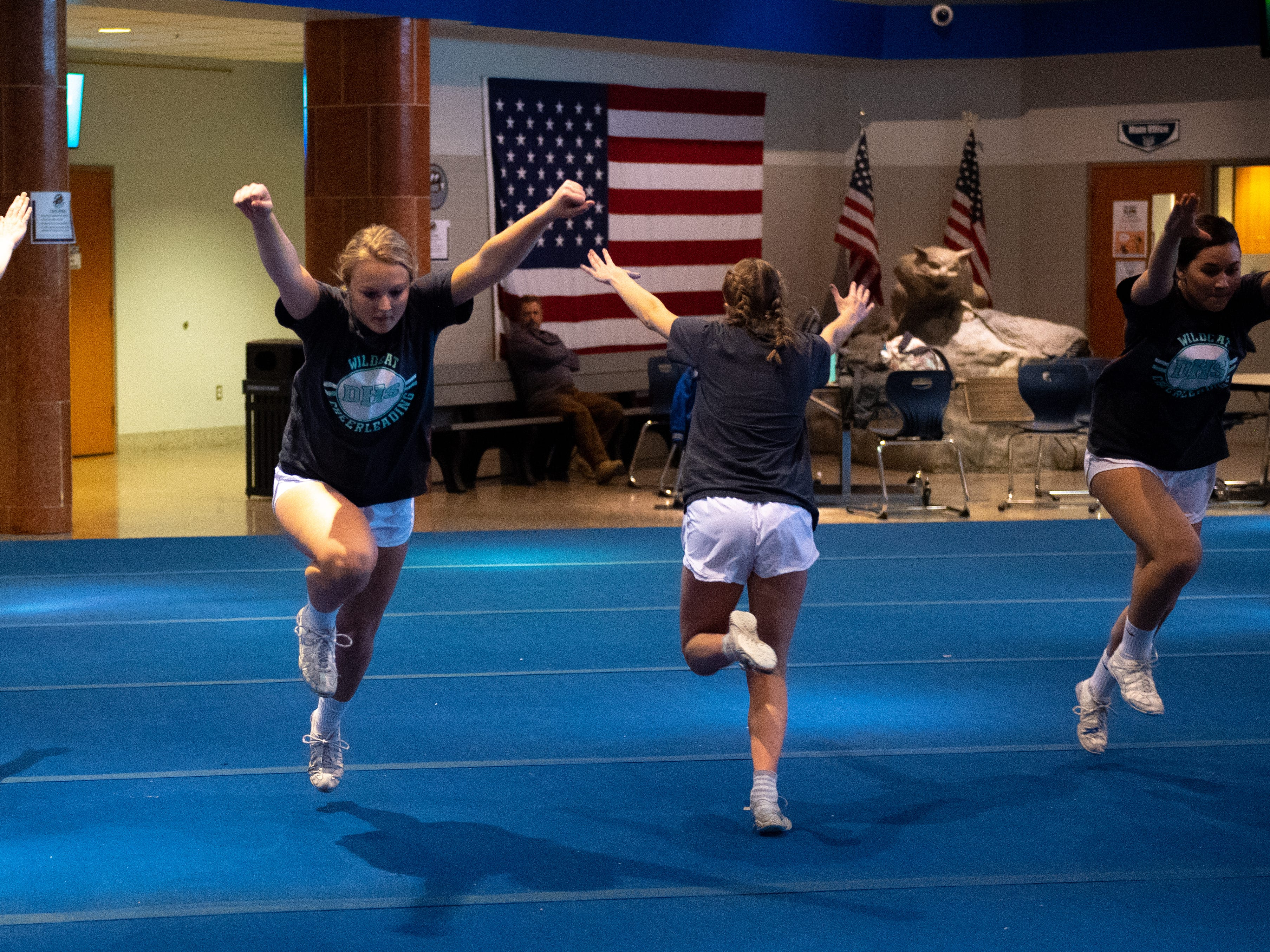 The team prepares to perform flips during Dallastown's competitive spirit practice, November 14, 2018.