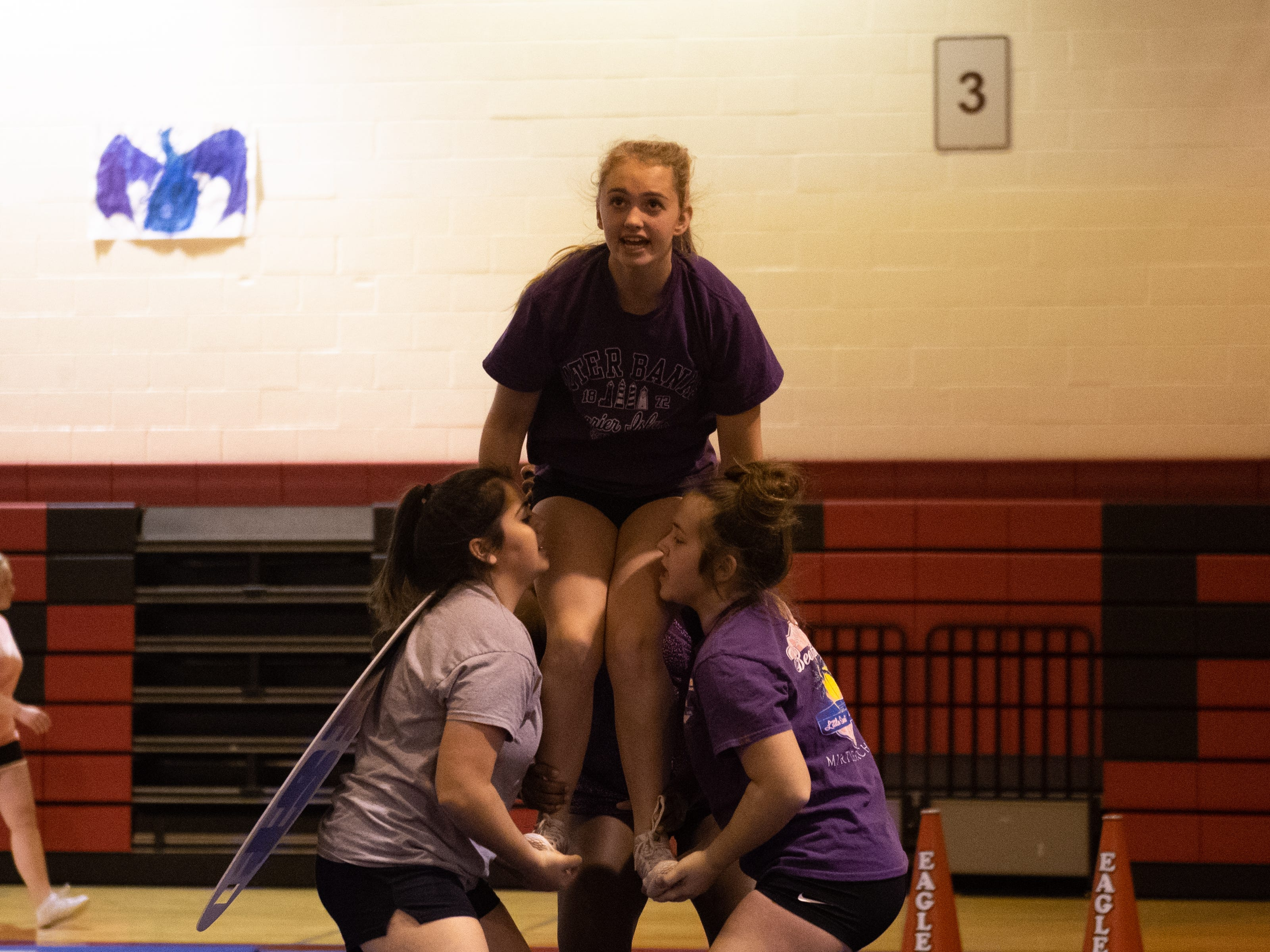 Londyn Sayers communicates with her team during Dover's competitive spirit practice, November 14, 2018.