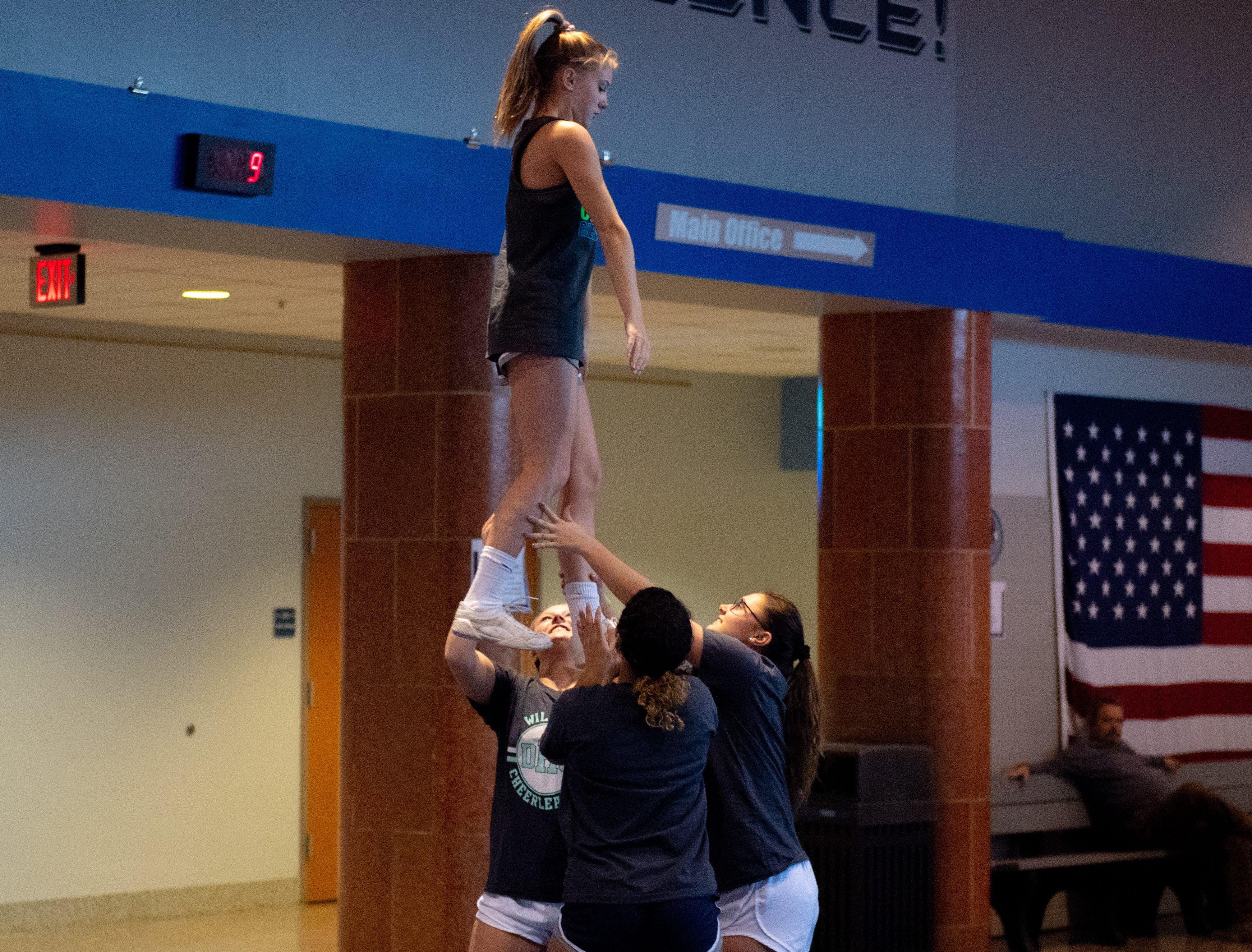 Taylor Whitmer prepares drop down after the stunt during Dallastown's competitive spirit practice, November 14, 2018.