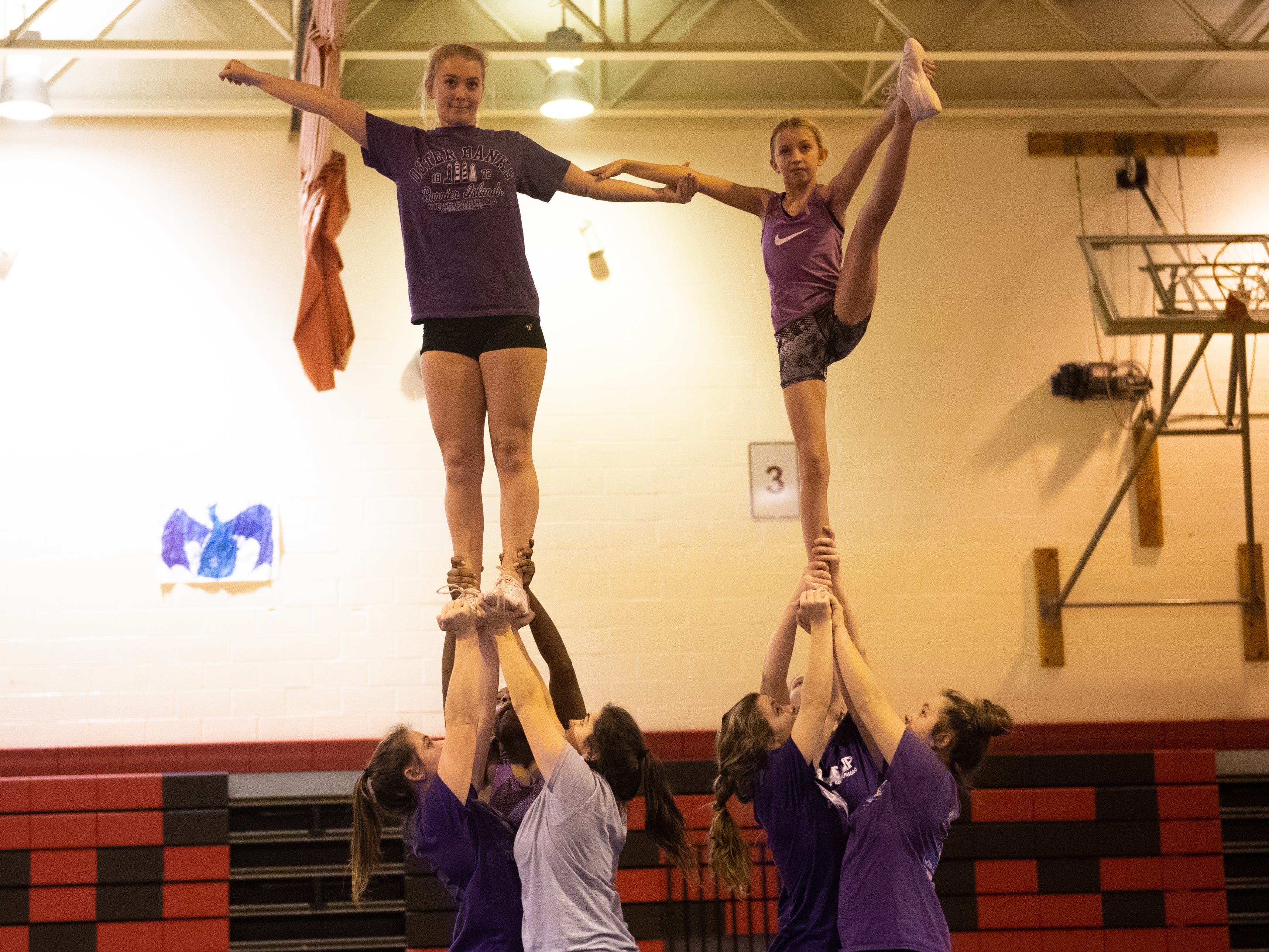 Dover's competitive spirit team practices the right side of the stunt, November 14, 2018.