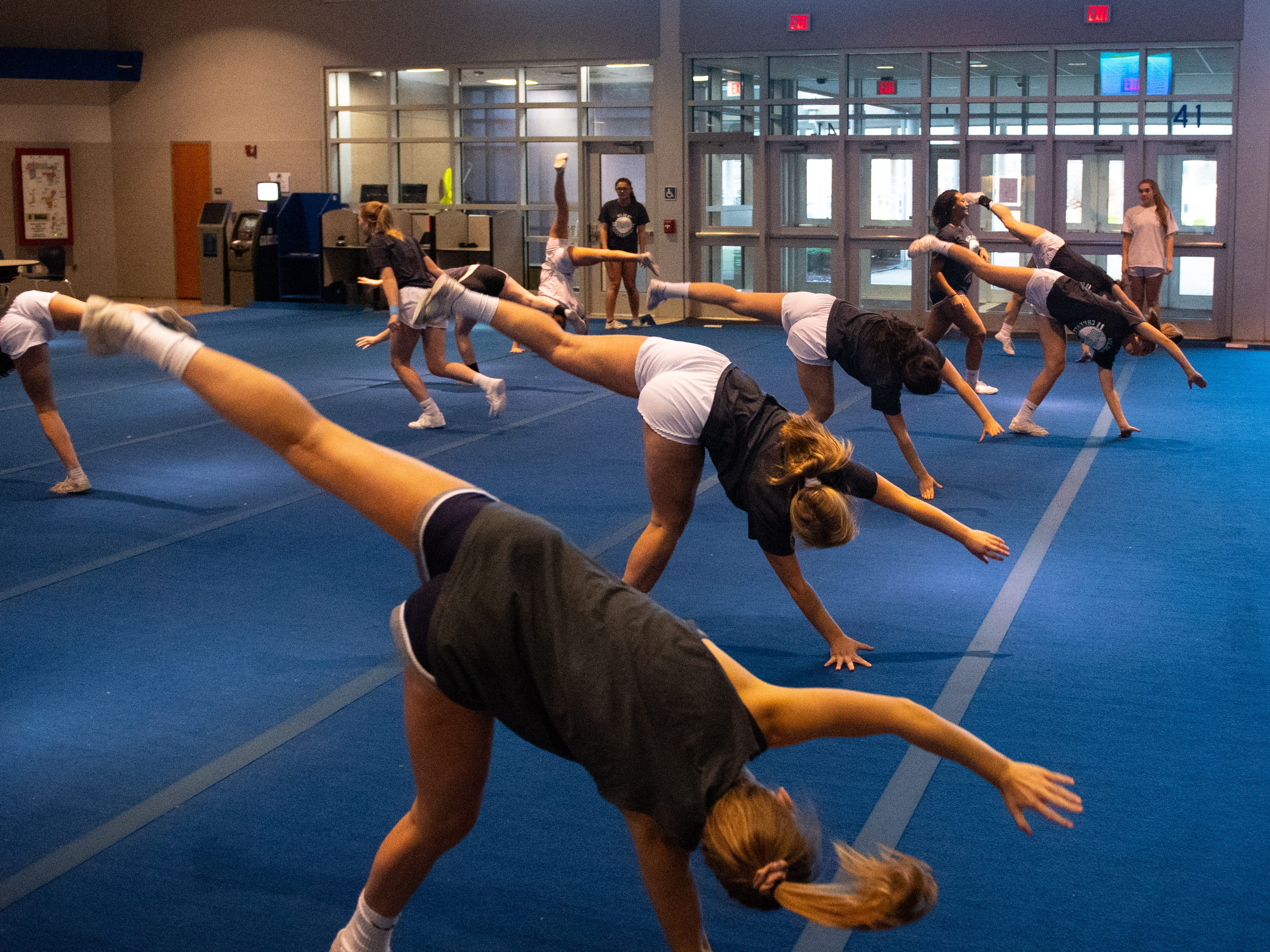 The entire team is in unison with their cartwheels during Dallastown's competitive spirit practice, November 14, 2018.